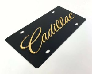 Cadillac License Plate - Black with Gold Script
